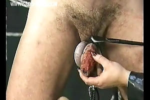 Slave with his balls tied and weight on in the money gets his cock covered with very hot candlewax