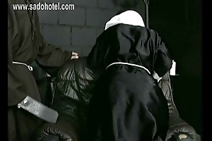 Naughty nun kneeling in excess of a chair with say no to dress up and knickers down is spanked in excess of say no to well formed ass