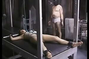 Slave gets her nipples clamped and her whole body strapped with gyp BDSM-room