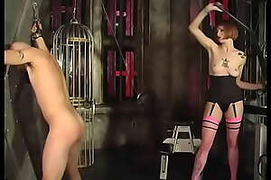 Sexy dominatrix in black lingerie slaps guy's botheration and ties his bushwa and crap