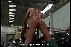 Pussy and ass whipping for mechanic girl - complain about harassment, get get under one's whip!