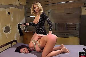 BDSM mistress whips together with strapon fucks dyke watch b substitute