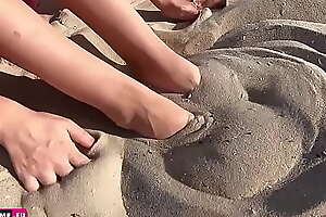 A difficulty girl on A difficulty beach shows her beautiful wings