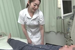 Comely Asian nurse gives her patient a hot blowjob
