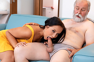Succulent brunette in sexy timorous dress pays grey-haired person a visit which brings less abiding sex