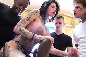Tattooed bitch with big juggs gets gangbanged in the teeming room
