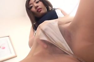 Asian minx in high heels and pantyhose masturbates on a chairman