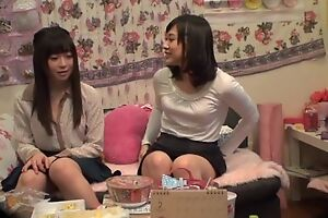 Charming Asian lady pleasuring her lesbian friend