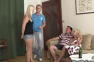 Older doll seduces dear girl into threesome