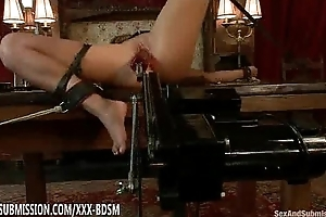 Pretty bondage babe gets scale with device